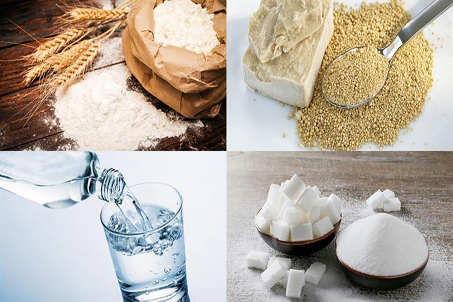 Nguyên liệu làm bánh mì: Bột mì đa dụng, men instant, nước ấm, bơ nhạt đun chảy, sữa không đường.