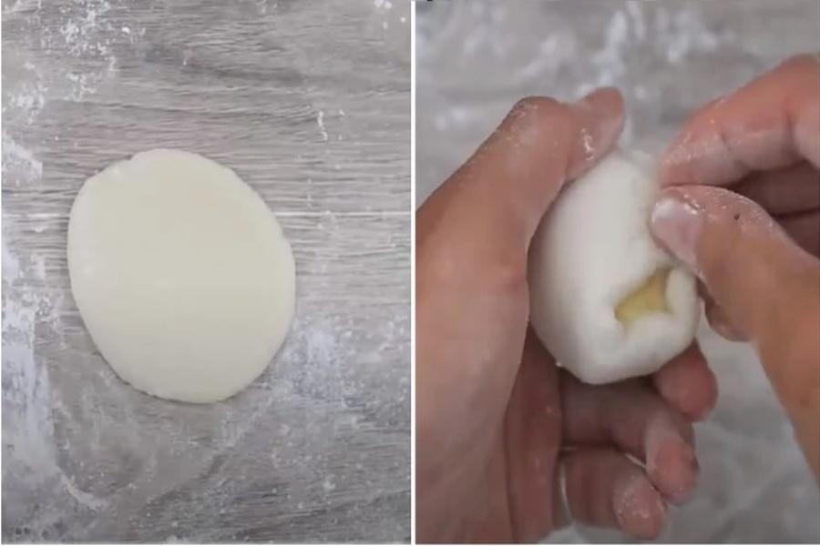 Miết từ từ phần vỏ để bao hết phần nhân còn lại. Cho viên nhân vào giữa bột rồi túm các mép để phần vỏ bao kín nhân.