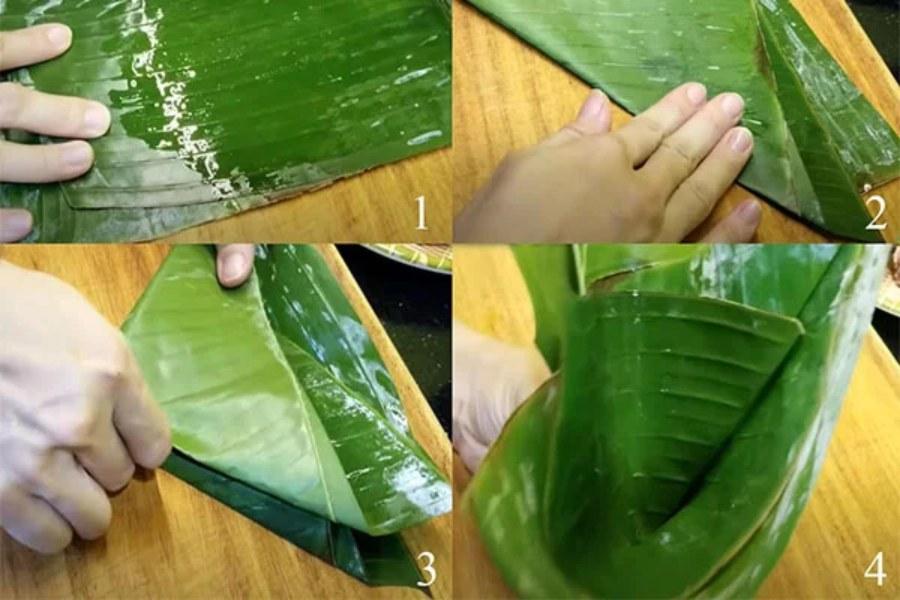 Làm ướt lá chuối. Gấp mép lá chuối thành hình phễu